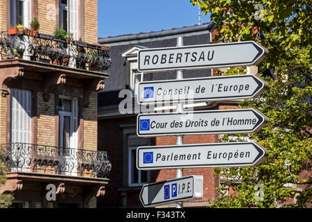 Signpost with directions to the several European Union office buildings in the European quarter at Strasbourg, France - Stock Photo