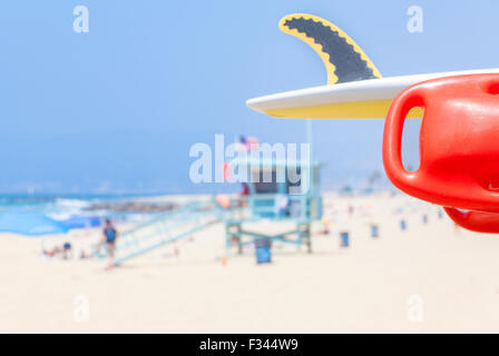 Lifeguard red buoy on a beach with lifeguard tower in distance, shallow depth of field, space for text, California, - Stock Photo