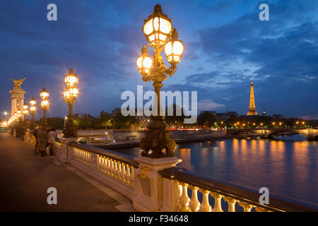 Pont Alexandre III, looking toward the Eiffel Tower over the River Seine at dusk, Paris, France - Stock Photo