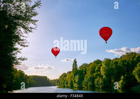 Hot-air balloons above River Cher at Chenonceaux. Indre-et-Loire, France. - Stock Photo