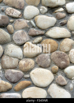 The smooth stone vertical background, design of wall or fence - Stock Photo