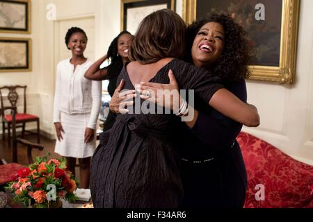 U.S. First Lady Michelle Obama greets television personality Oprah Winfrey at the White House August 27, 2013 in - Stock Photo