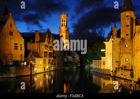 Evening view of the city from the Rozenhoedkaai in Bruges, West-Vlaanderen, Belgium - Stock Photo