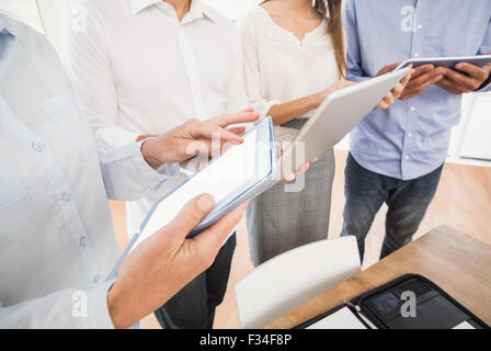 Business people using several electronic devices - Stock Photo