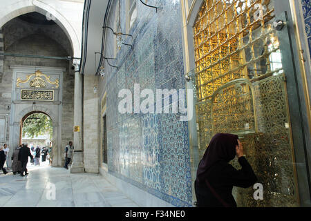 Istanbul, Turkey - September 21, 2015: Muslim woman look to inside from window of The tomb of Eyup Sultan - Stock Photo