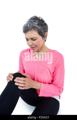 Mature woman suffering from knee pain - Stock Photo