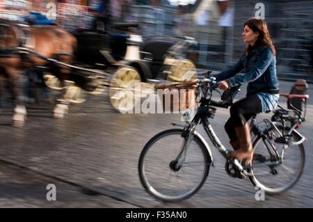 Bruges by bike. Cyclists are especially privileged in Bruges so if you can't beat them why not join them. There - Stock Photo