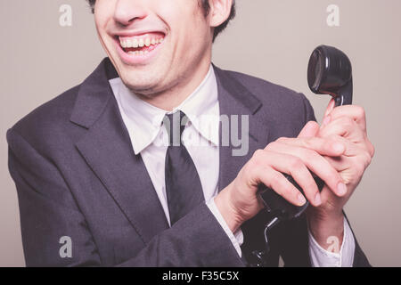 Happy young businessman is on the phone - Stock Photo