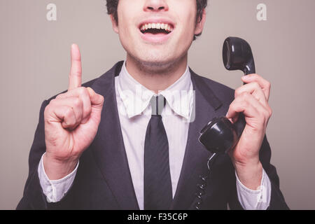 Young businessman on the phone gets a bright idea - Stock Photo