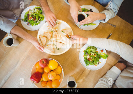 Business people having lunch in canteen - Stock Photo