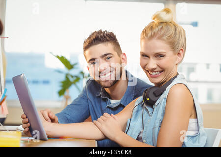 Business people using digital tablet - Stock Photo