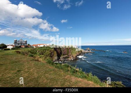 Coast in Santa Cruz Das Flores with the Church of Nossa Senhora da Conceição, Flores Island,  Azores - Stock Photo