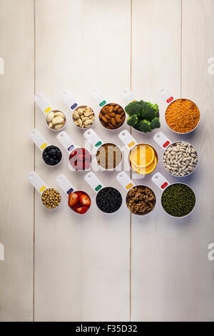 Portion cups of healthy ingredients - Stock Photo