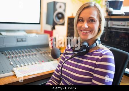 Portrait of happy young radio host - Stock Photo