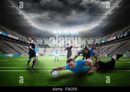 Composite image of rugby player doing a drop kick - Stock Photo