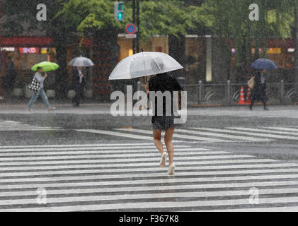 Ginza girl in rain - Stock Photo