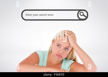 Composite image of close up of a sad woman standing behind a whiteboard - Stock Photo