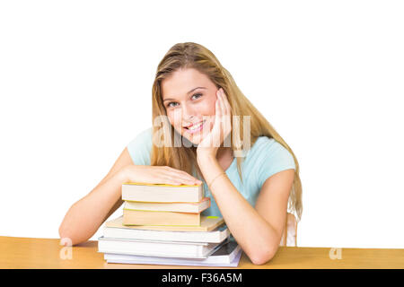 Composite image of portrait of female student in library - Stock Photo
