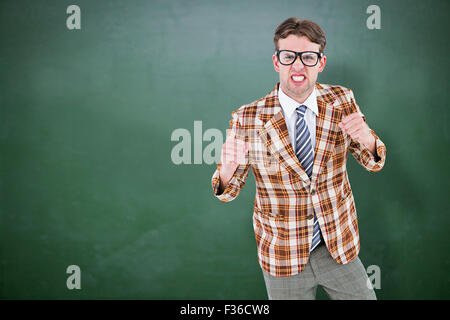 Composite image of angry geeky hipster looking at camera - Stock Photo