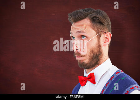 Composite image of geeky hipster wearing christmas vest - Stock Photo