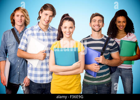 Composite image of students holding folders in college - Stock Photo