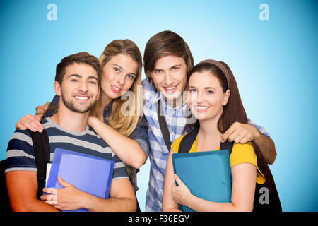 Composite image of students holding folders at college corridor - Stock Photo
