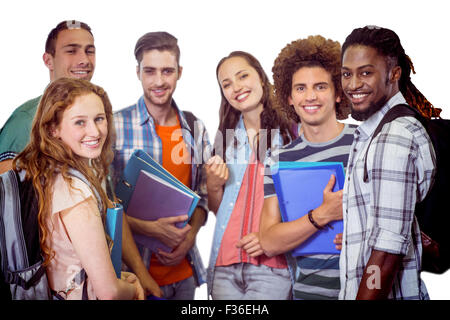 Composite image of smiling group of students holding folders - Stock Photo