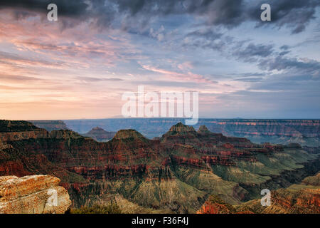 Summer sunrise over the Three Temples and the North Rim of Arizona's Grand Canyon National Park from Bright Angel - Stock Photo