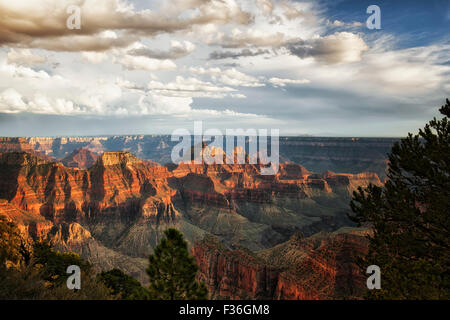 Summer evening storm clouds gather over the Three Temples and the North Rim of Arizona's Grand Canyon National Park. - Stock Photo