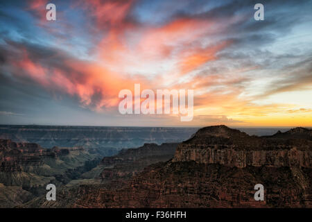 A spectacular sunset over the North Rim of Arizona's Grand Canyon National Park from Bright Angel Point. - Stock Photo