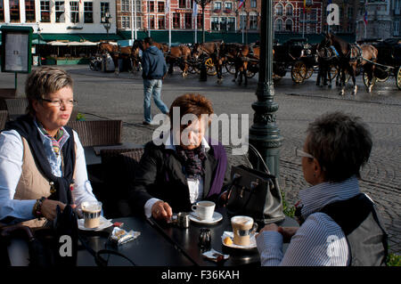 Bruges. Bars and restaurants in Markt. This attractive area is the centre piece of the city and at many times of - Stock Photo