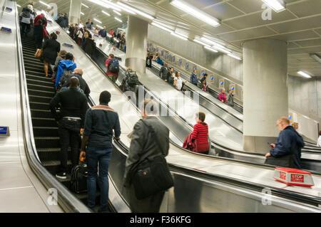 People riding the escalators on the London Underground system City of London England UK GB EU Europe - Stock Photo