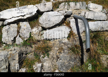 Mount Pasubio, locality Sogli Bianchi,  Veneto Pre-Alps. Moro fountain, the fountain is a little spring water.  - Stock Photo