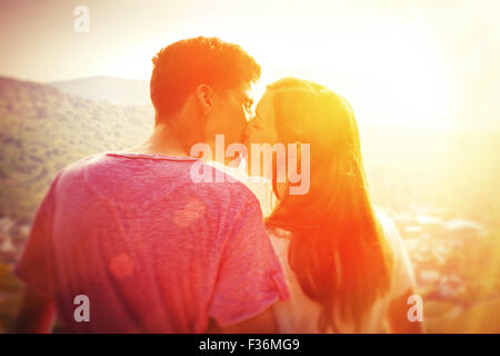 Young, kissing couple in the sun - Stock Photo