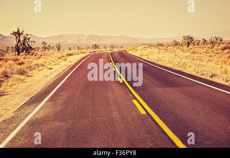 Retro old film style endless country highway, travel adventure concept, Joshua Tree National Park, USA. - Stock Photo
