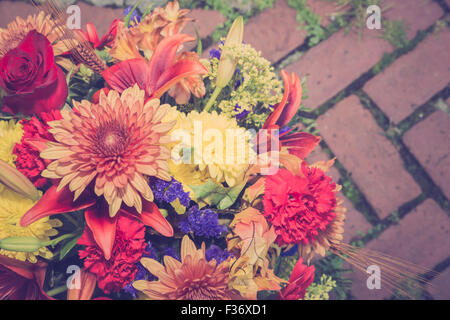Autumn colors floral bouquet on brick background with vintage filter effect - Stock Photo