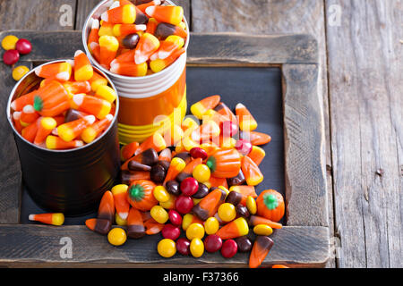 halloween candy in small tins on brown rustic table stock photo
