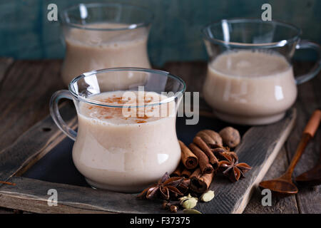 Warm masala tea with syrup and winter spices - Stock Photo