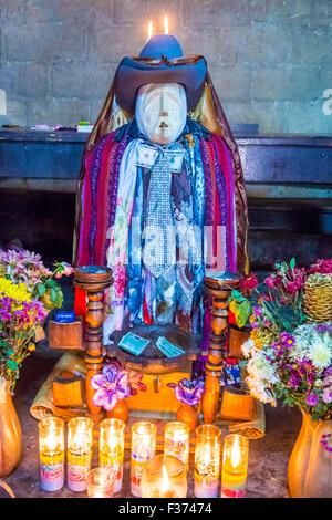 Shrine of El Maximon in Santiago De Atitlan , Guatemala  Maximon saint/devil is one of the strongest remnants of - Stock Photo