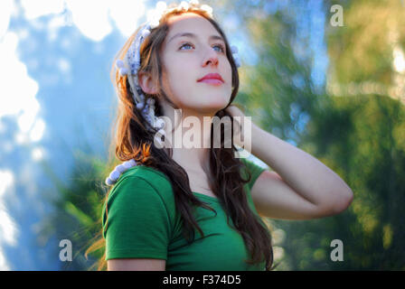 beautiful girl with blue eyes looking at the sky - Stock Photo