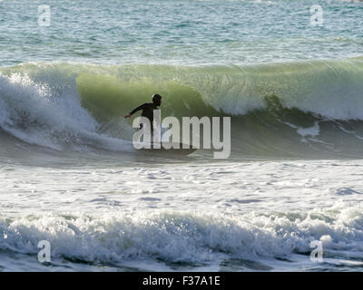 Surfer, riding a big wave in the sea, Liguria, Italy - Stock Photo