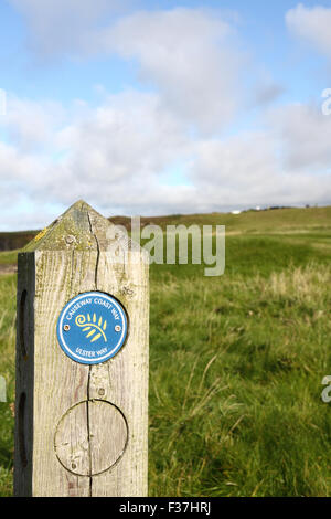 Causeway Coast Way marker post near Portstewart, Northern Ireland - Stock Photo