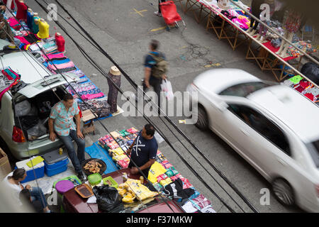 Sao Paulo, Brazil. 1st October, 2015. Everyday lifestyle - street scenes. Street vendors make barbecue while selling - Stock Photo