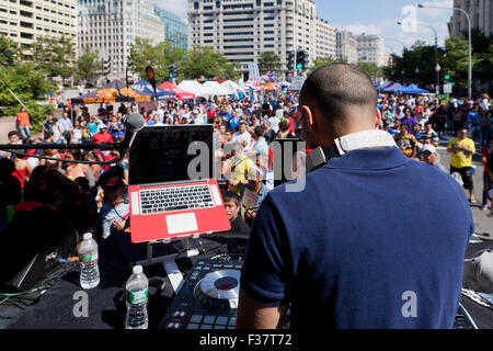 Mix DJ on stage at an outdoor concert - USA - Stock Photo