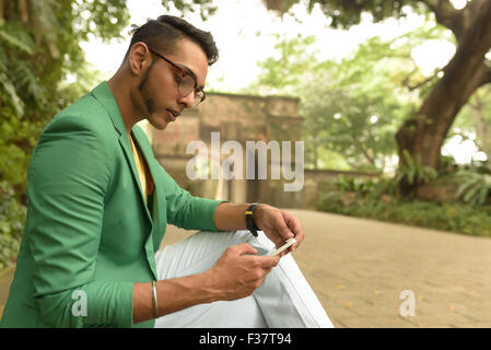 Asian , Man , Indian Ethnicities , Smart Phone , Casual Clothing , Outdoor . - Stock Photo