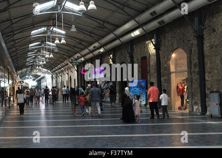 Izmir, Turkey - September 26, 2015: People shopping in old Kemeraltı Bazaar. - Stock Photo