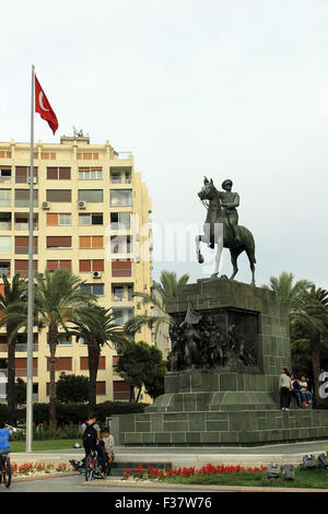 Izmir, Turkey - September 26, 2015: Peoples sit down around Ataturk statue in Izmir, Turkey - Stock Photo