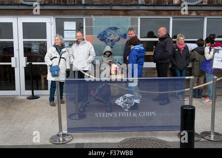 People the queue for Rick Stein's Fish and Chips Padstow Cornwall UK. - Stock Photo