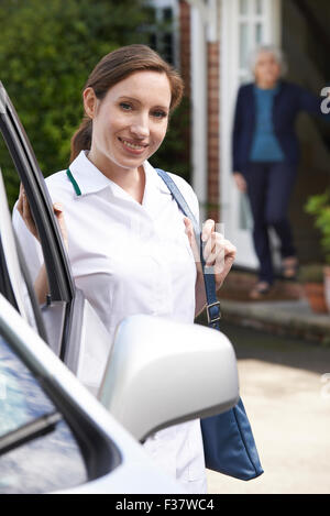 Female Care Worker Visiting Senior Woman At Home - Stock Photo
