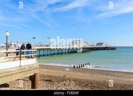 Worthing Pier on a sunny day in Summer with blue sky, in Worthing, West Sussex, England, UK. - Stock Photo